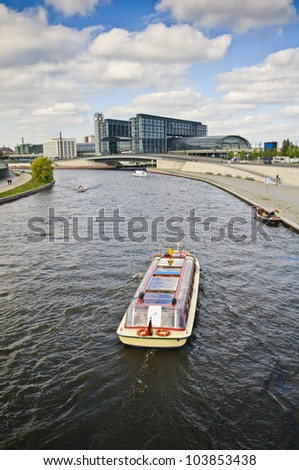 Boat on Spree river and main railway station in Berlin, Germany