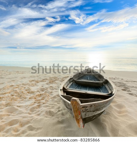 boat on the beach at sunrise...