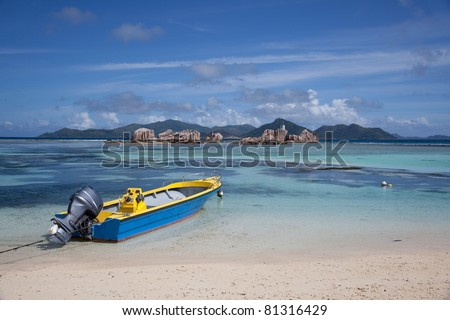 Boat on the beach in Seychelles La Digue island