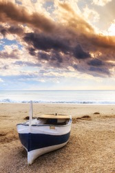Boat on the beach near Almeria at sunset time. Cabo de Gata Nijar Natural Park, Almer���­a. Spain. Andalusia