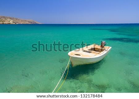 Boat on the blue lagoon of Vai beach, Crete - stock photo