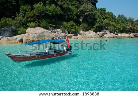 Boat on the blue sea - Perhentian, Malaysia - stock photo