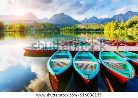 Boat on the dock surrounded mountains. Fantastic Shtrbske Pleso High Tatras. Slovakia, Europe.