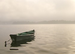 Boat on the foggy lake