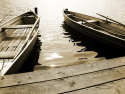 boat on the lake, sepia