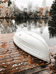Boat on the pier in autumn near the lake