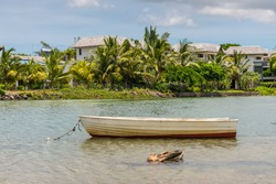 Boat on the river with villas in the background, Tamarin, Black River District, Mauritius