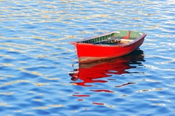 boat on water with red vivid color