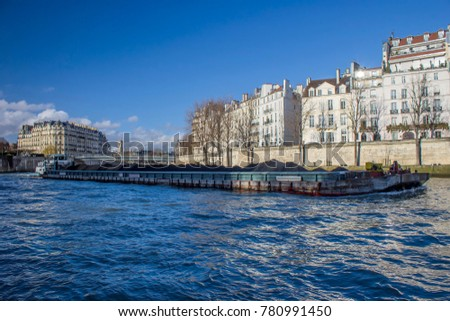 Shutterstock Boat platform on sena river in Paris, france