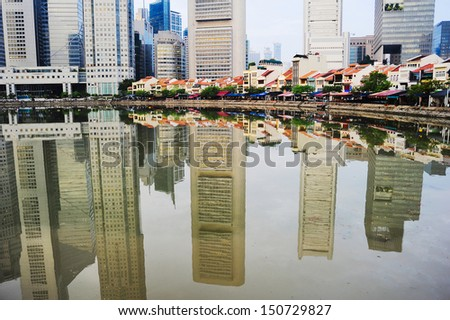Boat quay in Singapore with reflection in a river