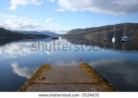 boat ramp and boats on Loch Broom Ullapool Scotland