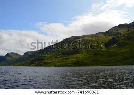 Boat Ride through a Scottish Glen #741690361
