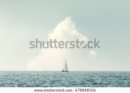 boat sailing in the sea under similar clouds #678848506