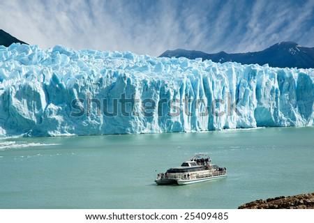 Boat sailing near Perito Moreno glacier, in Patagonia, Argentina.