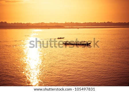 boat sailing on the river with sun ray