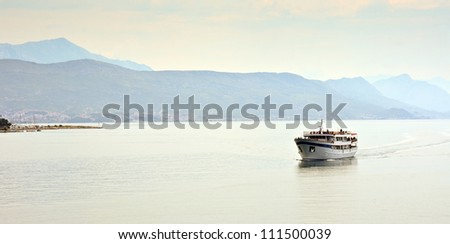 Boat sailing through tranquil landscape