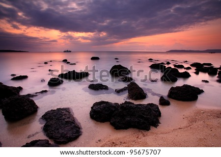 Boat Sea and rocks at sunset beautiful Koh Mak, Trat of Thailand