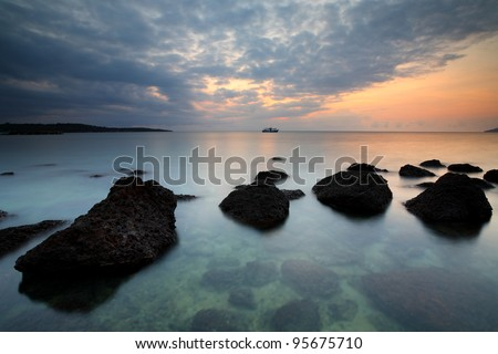 Boat Sea and rocks at sunset beautiful Koh Mak, Trat of Thailand
