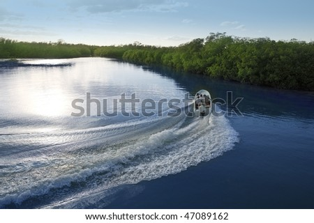 Boat ship wake prop wash curve on sunset lake river