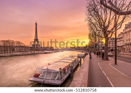 Boat waiting for the Seine river cruise in the shed of the Eiffel tower, Paris, France Stock photo ©
