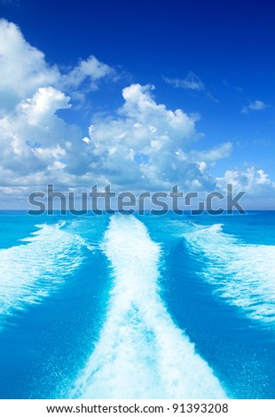 Boat wake prop wash on turquoise sea in sunny day
