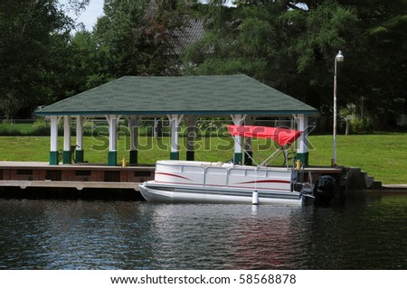 Boat with a red roof at the covered dock