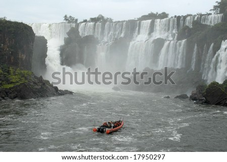 Boat with people in Iguazu waterfalls - Argentina. Iguazu Falls is the most visited place in Argentina.