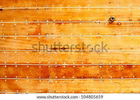 boat wooden hull texture detail with caulking putty and screw
