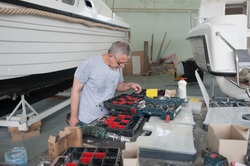 boat worker is looking for his corresponding tool