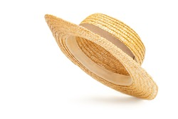 Boater straw hat flying isolated in studio. Concept of fashion clothing accessories and beach holidays