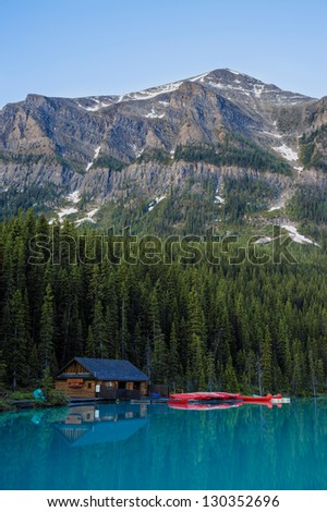 Boathouse and red canoes, Banff National Park, Canada