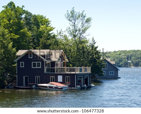 Boathouse with a boat - stock photo