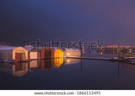 Boathouses on Kootenay Lake on calm winter
