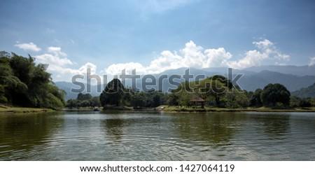 Boating activity at Taiping Lake, Taiping, Malaysia. A charming view Taiping Lake Garden, Perak, Malaysia #1427064119