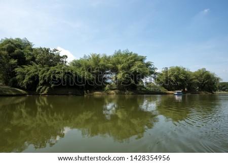 Boating activity at Taiping Lake, Taiping, Malaysia. A charming view Taiping Lake Garden, Perak, Malaysia #1428354956