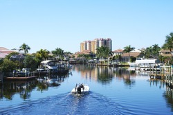 Boating along canal in Cape Coral Florida