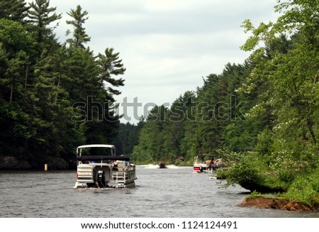 Boating at the Wisconsin river (USA) - Upper Dells part. Landscape and other recreational boats visible. #1124124491