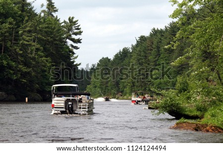 Boating at the Wisconsin river (USA) - while on an Upper Dells boat tour. Landscape and other recreational boats visible. #1124124494