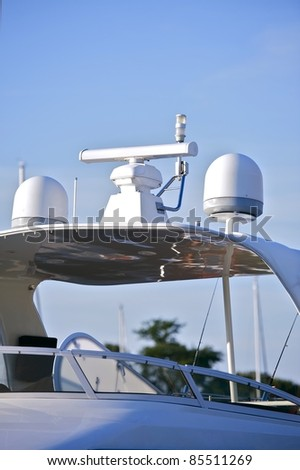 Boating: Navigation Equipment. Navi Instrument on the Top of the Motorboat. Vertical Photography. GPS and Radar.
