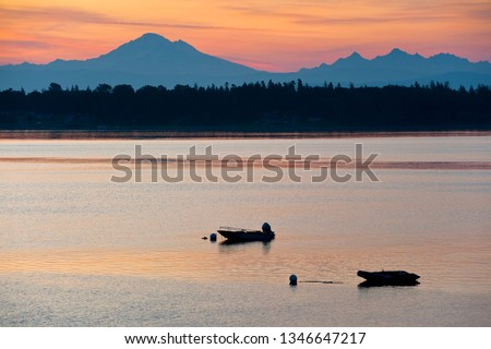 Boats Anchored in the Salish Sea At Sunrise With Mt. Baker in the Background. The view from Lummi Island in the Puget Sound area of Washington state.