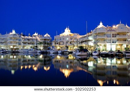 Boats and apartments in the marina at night, Benalmadena, Costa del Sol, Malaga, Province, Andalusia, Western Europe.