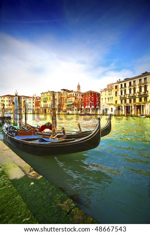 Boats and gondolas on the Grand Canal of Venice, Italy. - stock photo