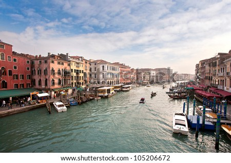 Boats and gondolas on the Grand Canal of Venice, Italy, blue sky - stock photo