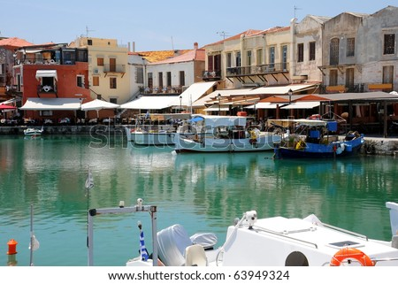 Boats and restaurants in the old Venetian port of Rethymno on Crete island in Greece