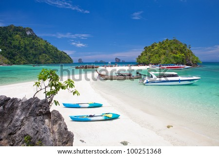 boats and the clear sea Phi Phi south of Thailand