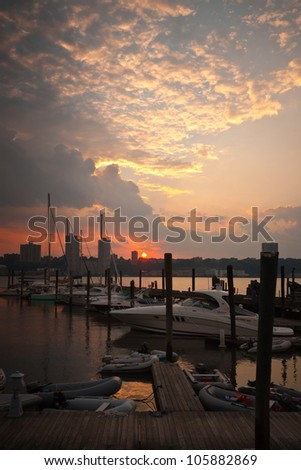Boats and yachts at dock during sunset.