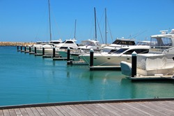 Boats and yachts in a marina.