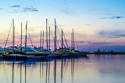 Boats and yachts in marina during sunset