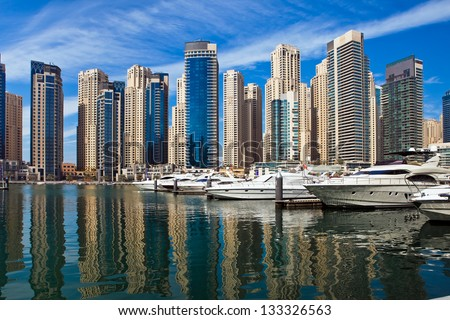 Boats and yachts parked in famous Marina district in Dubai, UAE.