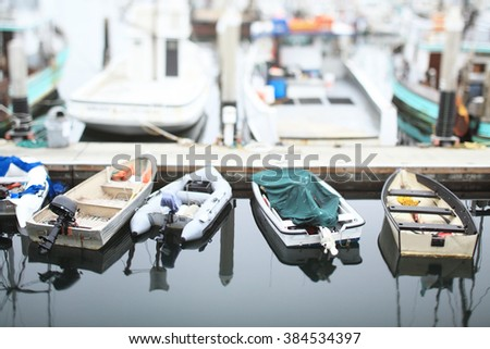 Boats at rest in the marina. Tilt-shift photography.  - stock photo